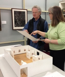 Larry Kagan reviewing the ceiling lighting schematic with Assistant Curator, Susan Bishop.